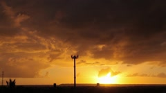 Communication tower with a sunset in background Stock Footage