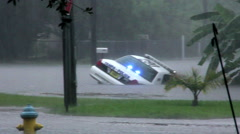 Police Car in Flooded Ditch Stock Footage