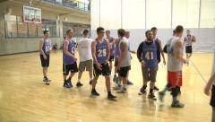 Men's basketball, players shaking hands after game Stock Footage