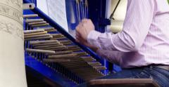 Carillon music  being played on bells by carillonneur Stock Footage
