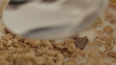 Spoon in a milk and granola bowl 1 Stock Footage