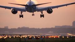 4K Airplane landing at sunrise Stock Footage