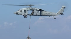 US Navy Blackhawk Helicopter Lifting Cargo Net Stock Footage