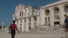 Haiti Earthquake Survivors Walk By Man Playing Guitar and Singing Arkistovideo
