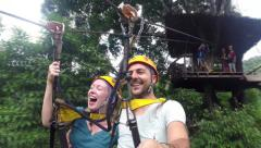 Tourists enjoying on ZIPLINE. Zip-line attraction. - stock footage