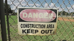 Danger Keep out sign on a fence Stock Footage