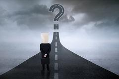Anonymous entrepreneur with question sign at road Stock Photos