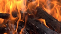 4k close up on fire and embers on wood stack, bonfire or camp fire Stock Footage