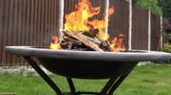 4k fire pit close up side view in the garden at summer time Stock Footage