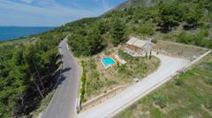 Aerial view of beautiful Villa Mir i More in Bol on island of brac, Croatia. Stock Footage