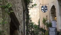 Zoom out from steps up narrow street of St Paul de Vence, France Stock Footage