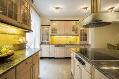 Granitic countertop in luxury kitchen Stock Photos