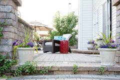 Low Angle View of Stone Patio of Affluent Home - stock photo
