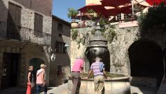 Tourists visit fountain in Saint Paul de Vence, France Stock Footage