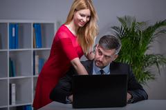 Attractive secretary and her chief Stock Photos