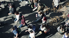 Protesting people walking through city, top view HD - stock footage