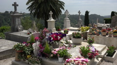 Cemetery with flowers on grave stones in St Paul de Vence, France Stock Footage