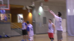 Rec League basketball players shoot around before a game Stock Footage