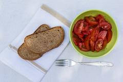 Tomato salad with brown bread Stock Photos