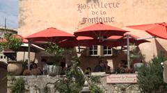 Tourists, restaurant hostellerie de la fontaine, Saint Paul de Vence, France Stock Footage