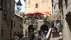Tourists visit fountain in St Paul de Vence, France Stock Footage