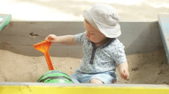 Mom with baby sandbox Stock Footage