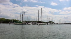 Cruising past yachts Stock Footage