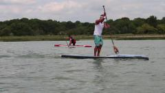 Paddle boarder and canoeist Stock Footage