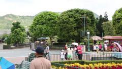 People in entertainment park Disneyland Resort Hong Kong Stock Footage