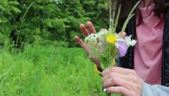 Bouquet in hands of young woman Stock Footage