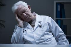 Sleeping at work - stock photo