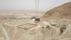 Stock Video Footage of Masada Cableway. Cable car way to canyon and over the tourists.