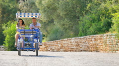 Greek Couple riding Surrey Bike in Greece Stock Footage
