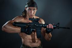 Man with an automatic weapon. Stock Photos