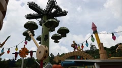 People on the attraction paratroopers, Disneyland Resort Hong Kong Stock Footage