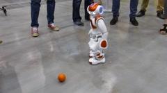 Humanoid autonomous robot plays a ball Stock Footage