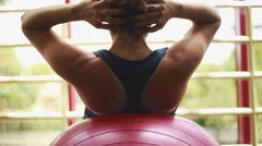 Woman doing abs on top of gym ball Stock Footage