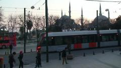 Tram at Istanbul Sultanahmet street on a background of Blue Mosque Stock Footage