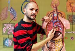 Biologist pointing at human heart Kuvituskuvat