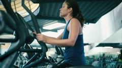 Woman working out on Elliptical Machine at Gym Stock Footage