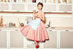 Stock Photo of Girl in apron