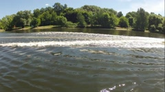 Stock Video Footage of Trip on boat on the river along the city park in summer sunny day. Timelapse.