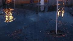 Modern splash fountain at night Stock Footage