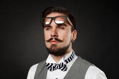 Handsome guy with beard and mustache in suit Stock Photos