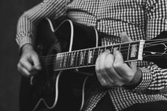 Acoustic guitar tuning and playing close up Stock Photos