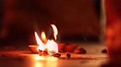 Votive flames and insence in Indian temple closeup  slow motion Stock Footage