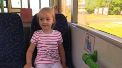 Little girl ride a bus on the seat Stock Footage