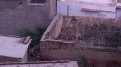 Rooftops in a busy town, inter-linked together. Shot in Govardhan, India. Pan an - stock footage
