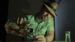 Drunk man drinking tequila at the bar - stock footage