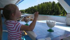 Girl eat ice cream on  floating pleasure river boat - stock footage